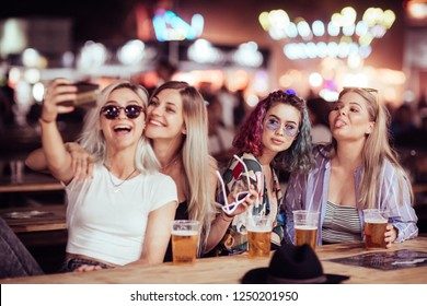 Group of female friends taking selfie at music festival