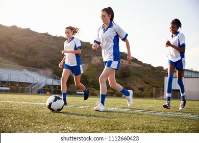Group Of Female High School Students Playing In Soccer Team