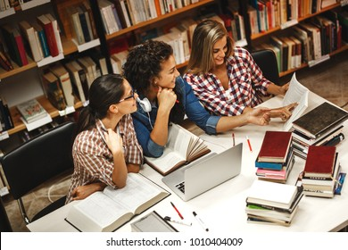 Group of female students study in the school library.Learning and preparing for university exam.Education concept.