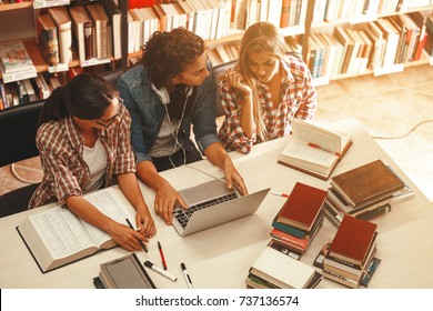 Group of female students study in the school library.Learning and preparing for university exam.