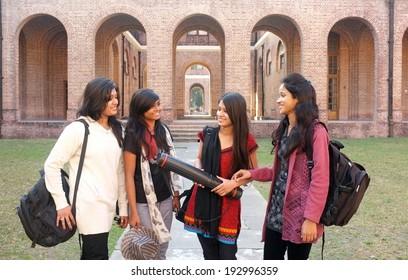 Group of female university students gossiping.