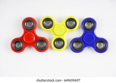 Group of fidget spinner stress relieving toy on white background