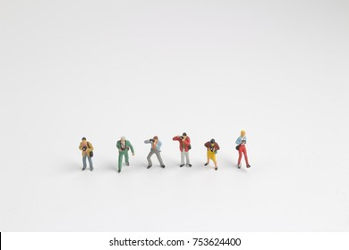 the group of a figure taking photo