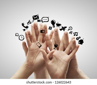 group of finger smileys with social media icons