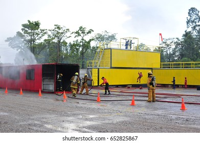 group of firefighters man are inject spray the water to fire accident on building