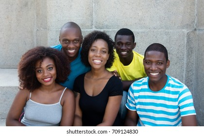 Group of five african american men and woman looking at camera