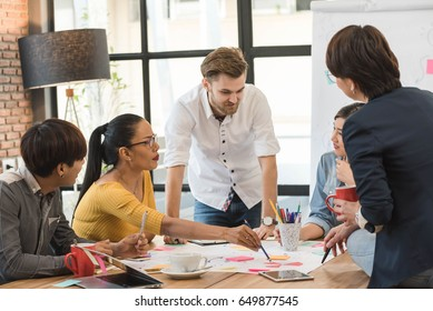 Group of five creative worker brainstorm together in office, new style of workspace, happy scene of people in office