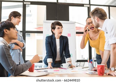 Group of five creative worker brainstorm together in office, new style of workspace, office arguement