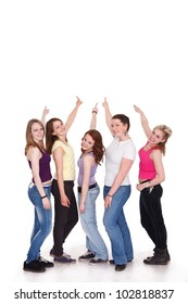 Group of five girls in a row pointing to copy space
