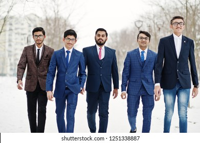 Group of five indian businessman in suits posed and walking outdoor in winter day at Europe.