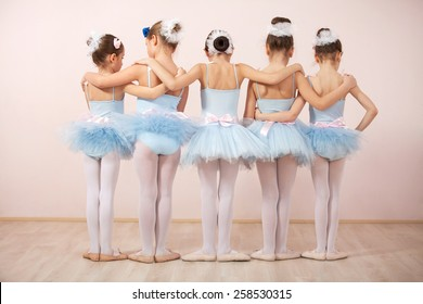 Group of five little ballerinas posing together with back to camera. They are good friend and amazing dance performers