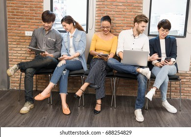 Group of five multi generation of creative use technology together of smartphone, table and laptop, internet lifestyle generation