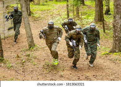 A group of five paintball players goes on the attack