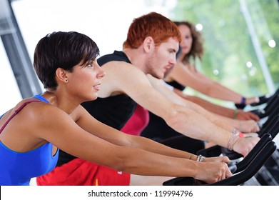 Group of five people in the gym, exercising their legs doing cardio training,Italy