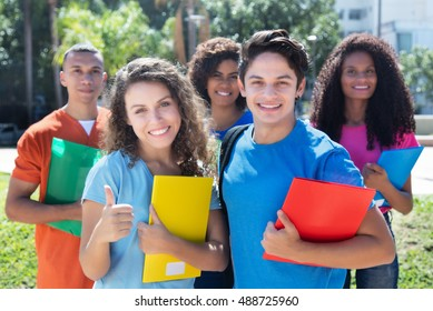 Group of five smart latin, american, caucasian and african students