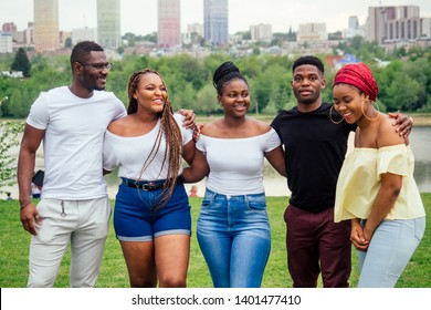 group of five smiling african-american men and women walking outside cloudy weather near the lake,exchange students in Russia