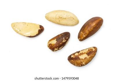 Group of five whole unshelled brazil nut flatlay isolated on white background