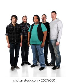 Group of five young men standing over a white background
