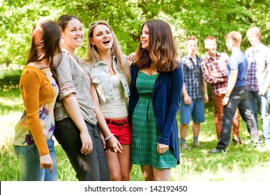 Group flirting young people in the park
