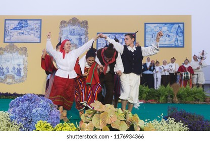 """Group of folklore of Madeira island perfoming at """"24 horas a bailar"""" festival in Santana city, Madeira Island, Portugal, July 2017."""