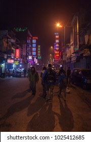 The group of foreign tourists in poor criminal blighted area along Main Bazar Street, Delhi, India. January 26, 2014.