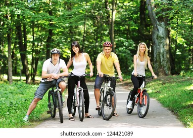 Group of four adults on bicycles in the countryside