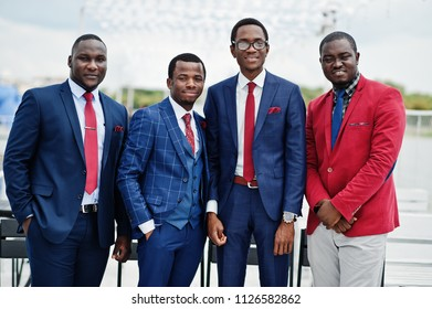 Group of four african american happy succesfull mans at suit. Rich black business mans.