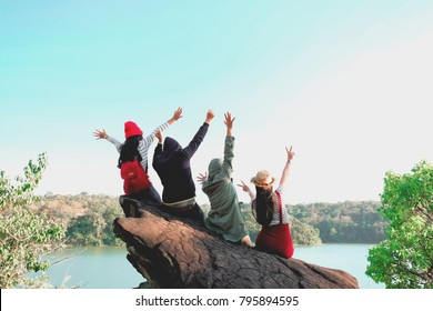 Group of Four best friends laughing and having a good time while hiking in wild forest, beauty of nature. Relax time on holiday concept travel, Thailand.