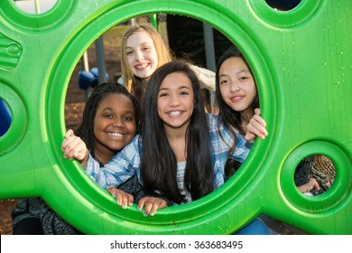 Group of four children with cultural diversity playing together
