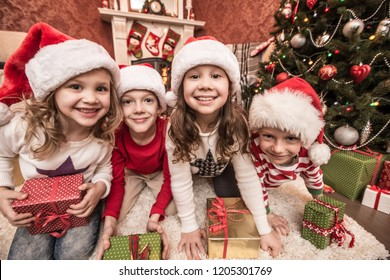 Group of four children with presents on Christmas party