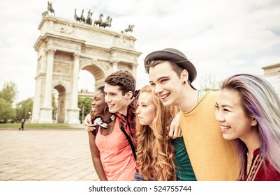Group of four friends laughing out loud outdoor, sharing good and positive mood.