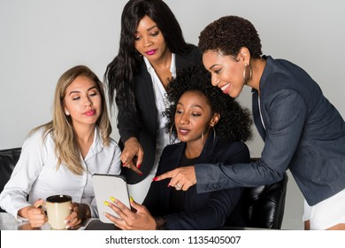 Group of four hispanic and african american businesswomen