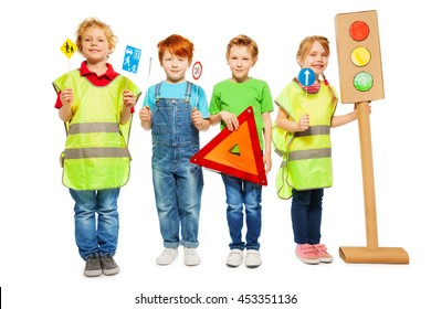 Group of four kids studying road safety rules