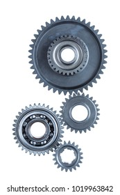 A group of four large steel gears are connected together over a plain white background.