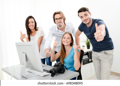 group of four photographer student learning creative portrait during photo shooting in photography school studio