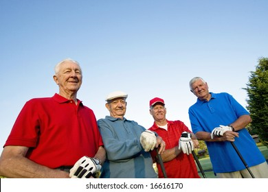 Group of Four Senior Golfers. Horizontally framed shot.