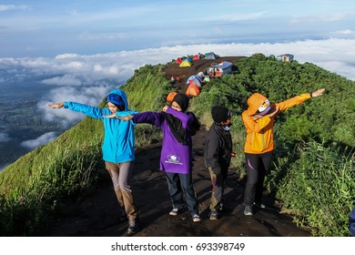 Group of four sexy, beautiful young happy women. Andong Mountain Indonesia. April 2017
