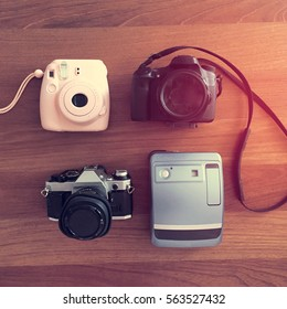 Group of Four Styles of Cameras: Film, Instant and Digital