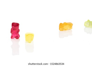Group of four whole gummy bear isolated on white background