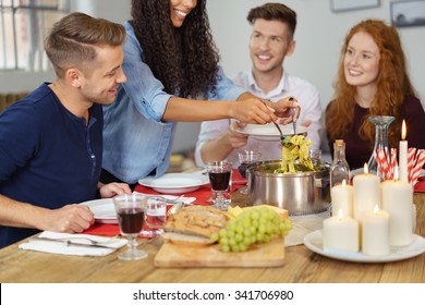 Group of Four Young Friends Having a Dinner Together While Celebrating Something.
