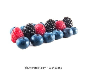 Group of fresh blueberries, raspberries and blackberries isolated on white background.