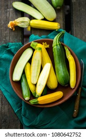 A group of fresh colorful zucchini on a wooden background