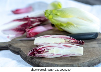 Group of fresh green Belgian endive or chicory and red Radicchio vegetables, also known as witlof salade close up