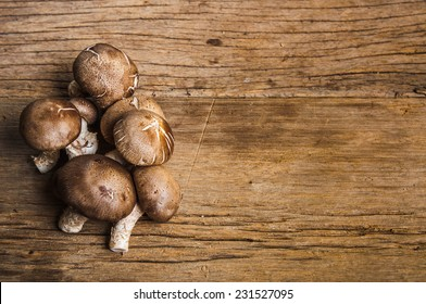 Group of Fresh Harvest Mushroom on Wood Table Background, Concept and Idea of Food Cook Rustic Still life Style, for background food wallpaper.