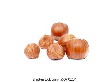 Group fresh hazelnuts isolated on white background