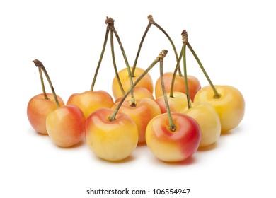 Group of fresh ripe Rainier cherries isolated on white background