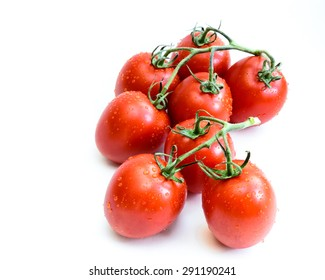 Group of fresh ripe Roma Tomatoes with water drops isolated on white background. Close-up view of Roma tomatoes, also known as Italian tomatoes or Italian plum tomatoes. Copy space.