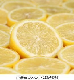 Group of fresh, sliced lemons forming a background