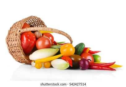 Group of fresh vegetables in basket on white background