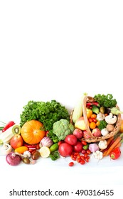 Group of fresh vegetables and fruits isolated on a white background.